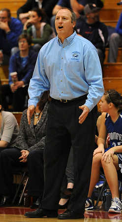 Broomfield coach, Mike Croell, reacts to the play on the court against Fairview on Saturday.<br /> Cliff Grassmick / December 12, 2009