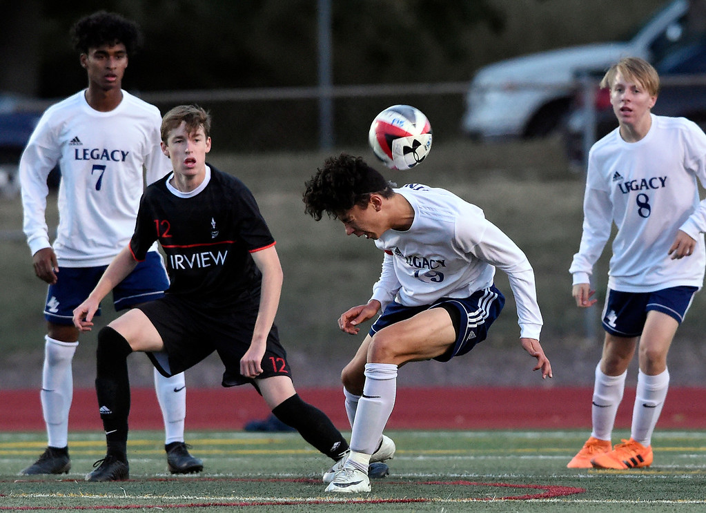 . BOULDER, CO - SEPTEMBER 25, 2018: Legacy High School\'s Ben Tuka heads the ball towards the goal during a game against Fairview on Tuesday in Boulder. More photos: BoCoPreps.com (Photo by Jeremy Papasso/Staff Photographer)
