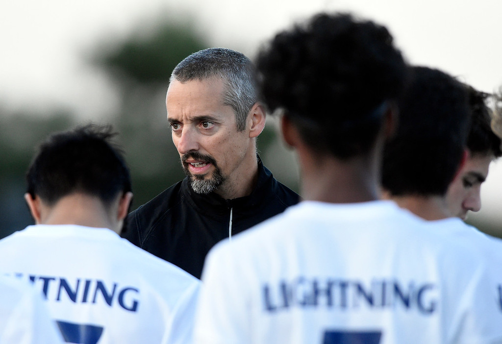 . BOULDER, CO - SEPTEMBER 25, 2018: Legacy High School Head Coach Anthony Romano talks with his team during a game against Fairview on Tuesday in Boulder. More photos: BoCoPreps.com (Photo by Jeremy Papasso/Staff Photographer)