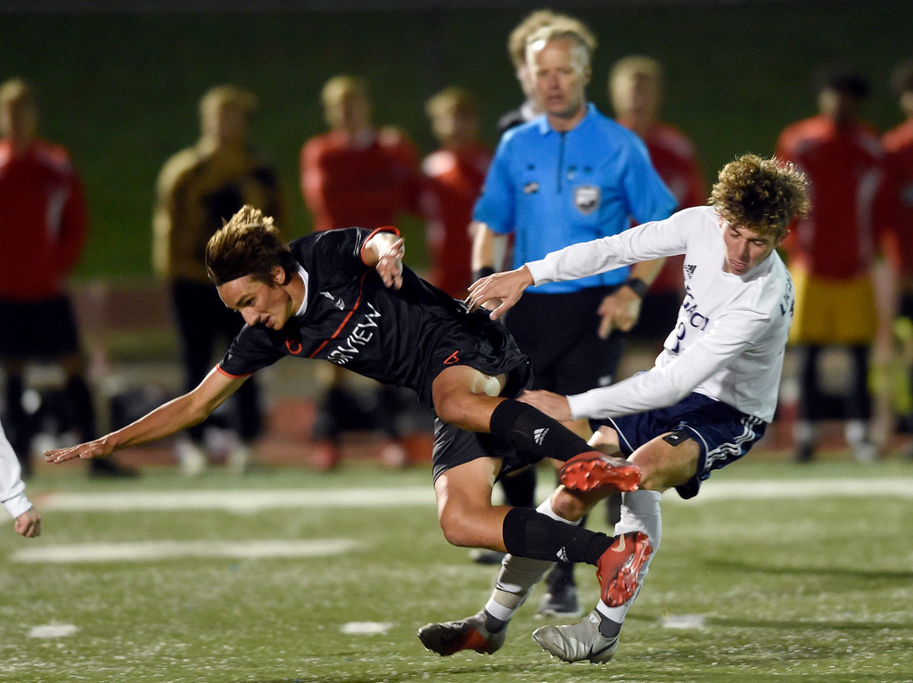 . BOULDER, CO - SEPTEMBER 25, 2018: Fairview High School\'s Sajji Singh, left, goes flying after colliding with Hunter Hance during a game against Legacy on Tuesday in Boulder. More photos: BoCoPreps.com (Photo by Jeremy Papasso/Staff Photographer)
