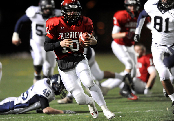 Fairview High School's Ben Schumacher (10) runs the ball down field while playing Columbine High School during the state playoffs at Recht Field in Boulder, Friday, Nov. 20, 2009. <br /> <br /> KASIA BROUSSALIAN / THE CAMERA