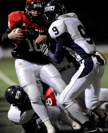 Fairview High School's Ben Schumacher (10) is pushed out of bounds by Columbine High School's Sean Neu (9) during the state playoffs at Recht Field in Boulder, Friday, Nov. 20, 2009. <br /> <br /> KASIA BROUSSALIAN / THE CAMERA