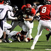 Fairview High School's Tucker Tharp (11) is taken down by Columbine High School defenders during the state playoffs at Recht Field in Boulder, Friday, Nov. 20, 2009. <br /> <br /> KASIA BROUSSALIAN / THE CAMERA