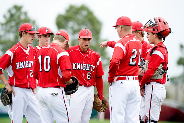 Fairview head coach Rick Harig talks with his team during the game against Fort Collins at Fairview High School in Boulder, Saturday, April 24, 2010. <br /> <br /> Kasia Broussalian