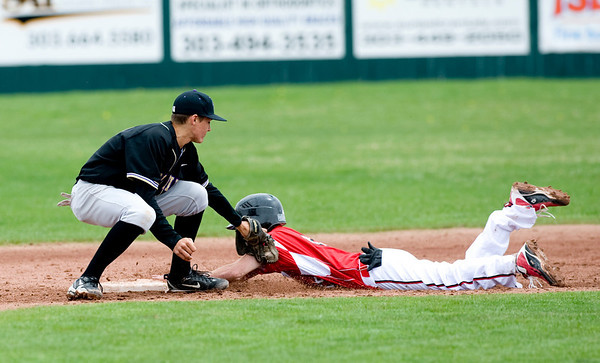 Fairview's Travis Scavo steals second as Fort Collin's Mike Schmidtbauer attempts to get him out at Fairview High School in Boulder, Saturday, April 24, 2010. <br /> <br /> Kasia Broussalian