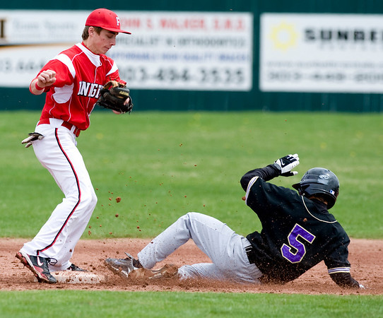 Fairview's Jakob Olsen tries to get Fort Collin's AJ Kandazzo out at second during the game at Fairview High School in Boulder, Saturday, April 24, 2010. <br /> <br /> Kasia Broussalian