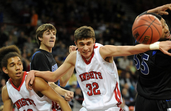 """Kenny Bell, left, Michael Melillo, both of Fairview, battle against Chris Martin (55) of Grandview.<br /> For more Fairview photos, go to photo galleries at  <a href=""""http://www.dailycamera.com"""">http://www.dailycamera.com</a>.<br /> Cliff Grassmick / March 5, 2010"""