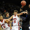 "Kenny Bell, left, Michael Melillo, both of Fairview, battle against Chris Martin (55) of Grandview.<br /> For more Fairview photos, go to photo galleries at  <a href=""http://www.dailycamera.com"">http://www.dailycamera.com</a>.<br /> Cliff Grassmick / March 5, 2010"