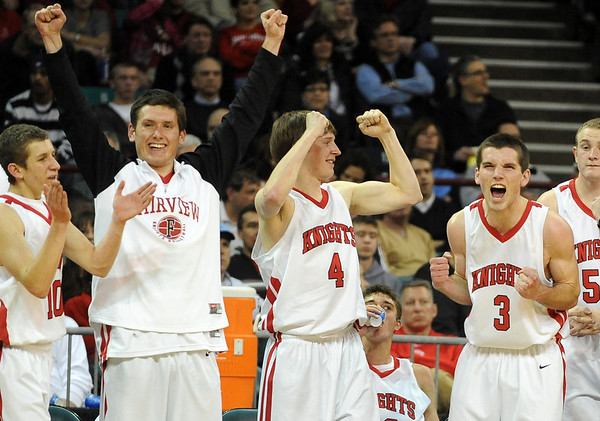 "Craig Saltarelli, left, Shane O'Neill, Will Oldham and Darragh O'Neill celebrate the  Fairview's state playoff win over Grandview on Friday.<br /> For more Fairview photos, go to photo galleries at  <a href=""http://www.dailycamera.com"">http://www.dailycamera.com</a>.<br /> Cliff Grassmick / March 5, 2010"