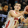 "Darragh O'Neill of Fairview, puts up a shot around Dominique Lawrence of Grandview.<br /> For more Fairview photos, go to photo galleries at  <a href=""http://www.dailycamera.com"">http://www.dailycamera.com</a>.<br /> Cliff Grassmick / March 5, 2010"