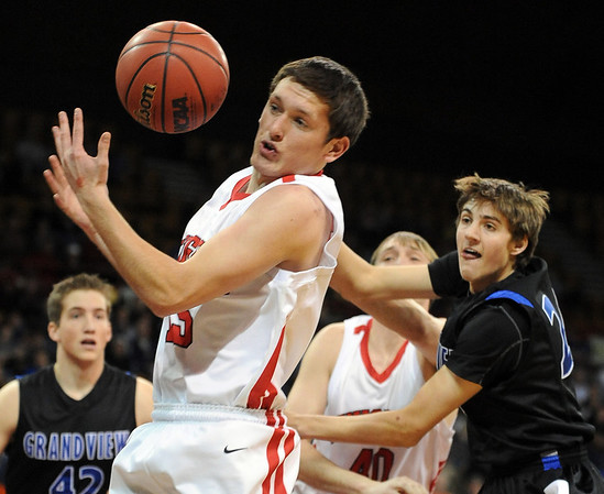 "Shane O'neill, left, gets a rebound as Kevin Gausman, right, of Grandview looks on.<br /> For more Fairview photos, go to photo galleries at  <a href=""http://www.dailycamera.com"">http://www.dailycamera.com</a>.<br /> Cliff Grassmick / March 5, 2010"