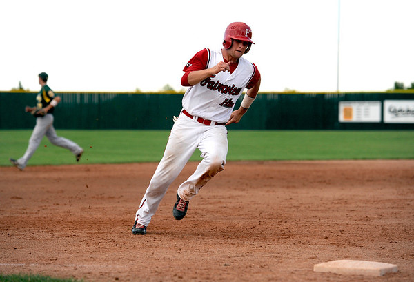 "Fairview Hisco's Brian Sture rounds third base as he heads home after being batted in by a teammate on Friday, July 22, during a game against Greeley GoJo Sports at Fairview High School in Boulder. Fairview defeated Greeley 8-7. For more photos of the game go to  <a href=""http://www.dailycamera.com"">http://www.dailycamera.com</a><br /> Jeremy Papasso/ Camera"