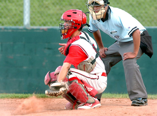 "Fairview Hisco catcher Evan Thoning digs the ball out of the dirt after a wild pitch was thrown on Friday, July 22, during a game against Greeley GoJo Sports at Fairview High School in Boulder. Fairview defeated Greeley 8-7. For more photos of the game go to  <a href=""http://www.dailycamera.com"">http://www.dailycamera.com</a><br /> Jeremy Papasso/ Camera"