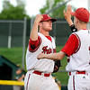 "Fairview Hisco pitcher Brian Sture, left, gets congratulated by a teammate, No. 13, not on roster, after closing the game with a victory on Friday, July 22, during a game against Greeley GoJo Sports at Fairview High School in Boulder. Fairview defeated Greeley 8-7. For more photos of the game go to  <a href=""http://www.dailycamera.com"">http://www.dailycamera.com</a><br /> Jeremy Papasso/ Camera"