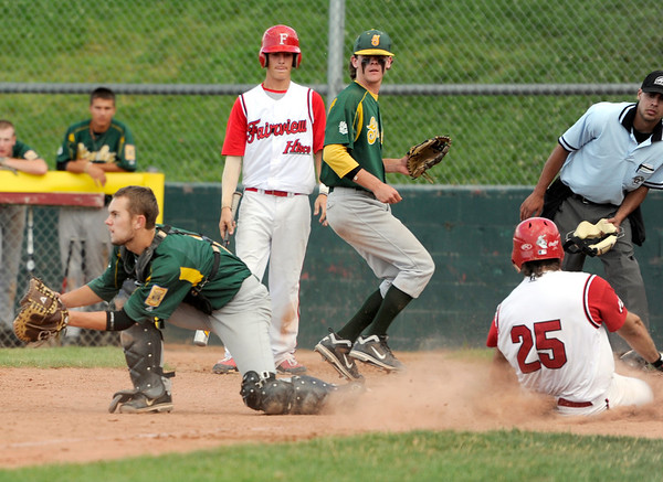 "Fairview Hisco's Rocky Desantis, right, slides into home plate safely past Greeley catcher Sean McCartney on Friday, July 22, during a game against Greeley GoJo Sports at Fairview High School in Boulder. Fairview defeated Greeley 8-7. For more photos of the game go to  <a href=""http://www.dailycamera.com"">http://www.dailycamera.com</a><br /> Jeremy Papasso/ Camera"
