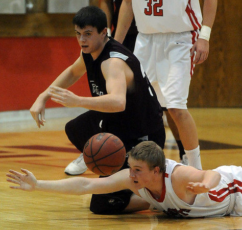 Daniel Flora of Fairview goes to the floor to get a loose ball lost by Matt Lloyd of Horizon.<br /> Cliff Grassmick / February 5, 2010