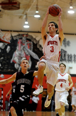 Darragh O'Neill of Fairview gets a lay up on a steal past Nick Lehto of Horizon on Friday.<br /> Cliff Grassmick / February 5, 2010