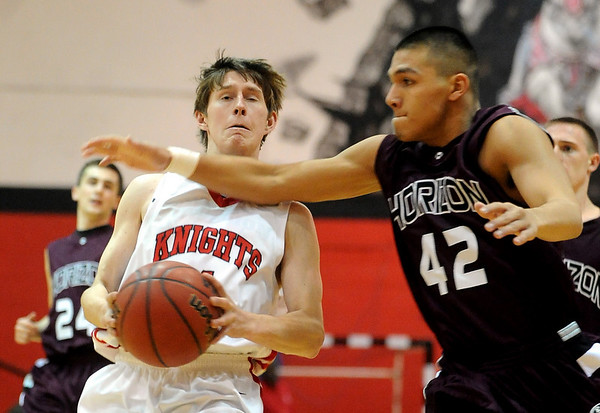 Will Oldham of Fairview gets the ball knocked away by Joe Gonzales of Horizon.<br /> Cliff Grassmick / February 5, 2010