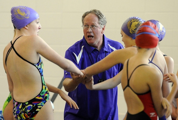"Boulder High Swim coach, Curt Colby,  gets his relay team fired up before the 200-yard medley relay.<br /> For more photos of the meet, go to  <a href=""http://www.dailycamera.com"">http://www.dailycamera.com</a>.<br /> Cliff Grassmick / December 3, 2010"