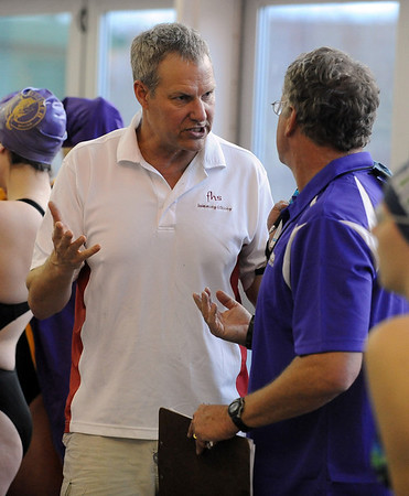 "Fairview swim coach, Bob Smartt, left, talks to Boulder coach, Curt Colby, during the Fairview Invitation.<br /> For more photos of the meet, go to  <a href=""http://www.dailycamera.com"">http://www.dailycamera.com</a>.<br /> Cliff Grassmick / December 3, 2010"