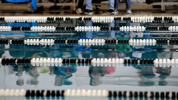 """Swimming fans are reflected in the South Boulder Rec Center Pool during the Fairview Invitational on Friday.<br /> For more photos of the meet, go to  <a href=""""http://www.dailycamera.com"""">http://www.dailycamera.com</a>.<br /> Cliff Grassmick / December 3, 2010"""