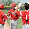 """Evan Thoning of Fairview comes home after hitting a homerun in the 6th inning of the second game against Monarch.<br /> For a photo gallery of the game, go to  <a href=""""http://www.dailycamera.com"""">http://www.dailycamera.com</a>.<br /> Cliff Grassmick / July 16, 2011"""