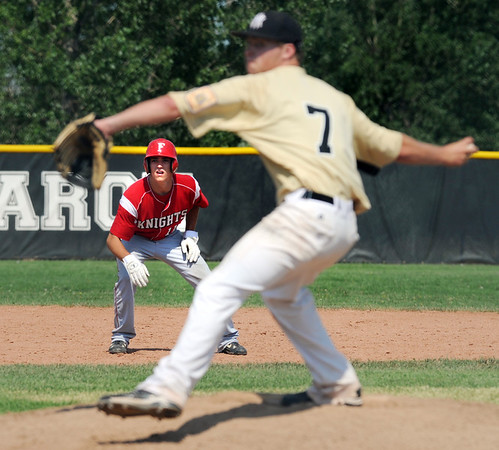 """Will Storrman of Fairview watches pitcher Austin Roberts of Monarch.<br /> For a photo gallery of the game, go to  <a href=""""http://www.dailycamera.com"""">http://www.dailycamera.com</a>.<br /> Cliff Grassmick / July 16, 2011"""