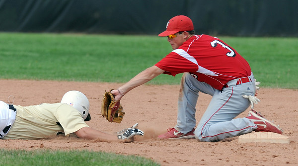 "Levi Ensign of Monarch is tagged out by Cam Frazier of Fairview.<br /> For a photo gallery of the game, go to  <a href=""http://www.dailycamera.com"">http://www.dailycamera.com</a>.<br /> Cliff Grassmick / July 16, 2011"