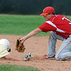 """Levi Ensign of Monarch is tagged out by Cam Frazier of Fairview.<br /> For a photo gallery of the game, go to  <a href=""""http://www.dailycamera.com"""">http://www.dailycamera.com</a>.<br /> Cliff Grassmick / July 16, 2011"""
