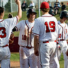 Fairview's Tucker Tharp is congratulated by teammates after hitting a home run during the game against Monarch at Fairview High School in Boulder, Thursday, April 15, 2010.