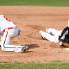 Monarch's Issac Spence (right) slides back to first while Fairview's Roby Gordon waits for the return ball during the game at Fairview High School in Boulder, Thursday, April 15, 2010.