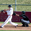 Fairview's Will Stoorman swings at the ball while Monarch's  Conner Dunn catches during the game at Fairview High School in Boulder, Thursday, April 15, 2010.