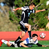 Cole Nielson, top, of Mountain Range, jumps over Darragh O'Neill of Fairview during the first half on Thursday.<br /> Cliff Grassmick / October 15, 2009