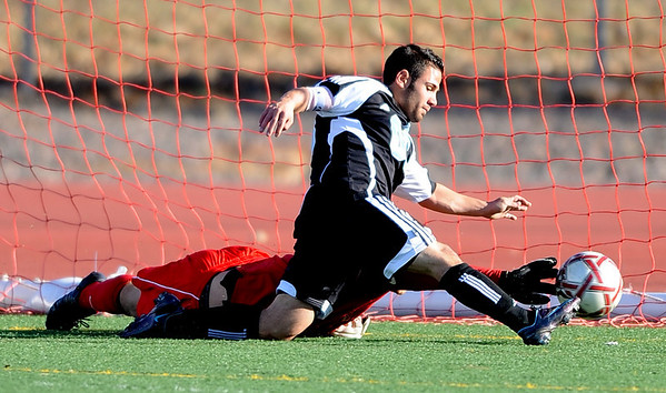 Christian Caruso (00) of Mountain Range scores past Louis Lish of Fairview to tie the score at 1.<br /> Cliff Grassmick / October 15, 2009