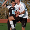 Max Shein (5) of Fairview and Austin Martin of Mountain Range, battle on the header.<br /> Cliff Grassmick / October 15, 2009