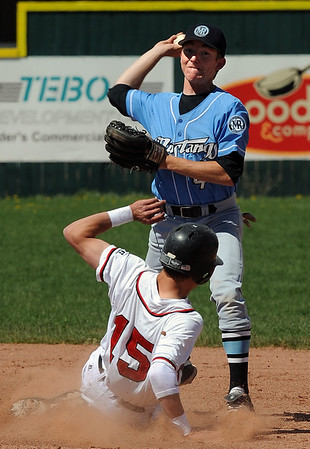 "Anthony Malgieri of Mountain Range, turns a double play as Evan Thoning of Fairview  gets to second.<br /> For more photos , go to  <a href=""http://www.dailycamera.com"">http://www.dailycamera.com</a><br /> Cliff Grassmick / May 1, 2010"