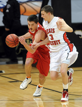 Darragh O'Neill of Fairview dribbles through Tanner Samson of Regis Jesuit in the 5A Colorado State Championship game.<br /> <br /> Cliff Grassmick / March 13, 2010