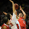 Shane O'Neill  of Fairview puts up a shot over Ryan Winters of Regis.<br /> <br /> Cliff Grassmick / March 13, 2010