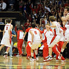 The Regis Jesuit players and fans celebrate the 5A Colorado State Championship on March 13, 2010.<br /> <br /> Cliff Grassmick / March 13, 2010