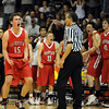 Shane O'Neill, left, and the Fairview bench are excited about getting the game to overtime against Regis.<br /> <br /> Cliff Grassmick / March 13, 2010