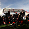 Fairview High School's football team storms the field before the game against Pomona High School during the class 5A State Semifinals at Recht Field in Boulder, Saturday, Nov. 28, 2009. <br /> <br /> KASIA BROUSSALIAN /THE CAMERA