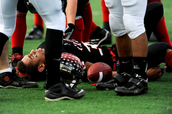 Fairview High School's Kenny Bell (35) is slightly injured after bringing the ball to the goal line while playing Pomona High School during the class 5A State Semifinals at Recht Field in Boulder, Saturday, Nov. 28, 2009. <br /> <br /> KASIA BROUSSALIAN /THE CAMERA