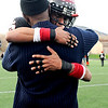 Fairview High School's Kenny Bell (35) hugs his grandfather, Terry Lawton, after losing to Pamona High School, 42-26, during the class 5A State Semifinals at Recht Field in Boulder, Saturday, Nov. 28, 2009. <br /> <br /> KASIA BROUSSALIAN /THE CAMERA