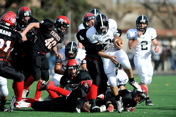Fairview High School's Mike Bastin (4) takes down Pomona High School's Nathan Grimes (8) during the class 5A State Semifinals at Recht Field in Boulder, Saturday, Nov. 28, 2009. <br /> <br /> KASIA BROUSSALIAN /THE CAMERA