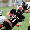 Fairview High School's Tucker Tharp (11) is tackled by Pomona High School's Cody Morton (3) and Trey Reynonlds (82) during the class 5A State Semifinals at Recht Field in Boulder, Saturday, Nov. 28, 2009. <br /> <br /> KASIA BROUSSALIAN /THE CAMERA