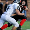 Fairview High School's Ben Schumacher (10) runs the ball as Pomona High School's Nathan Grimes (8) and Daijon Tyler (9) defend during the class 5A State Semifinals at Recht Field in Boulder, Saturday, Nov. 28, 2009. <br /> <br /> KASIA BROUSSALIAN /THE CAMERA
