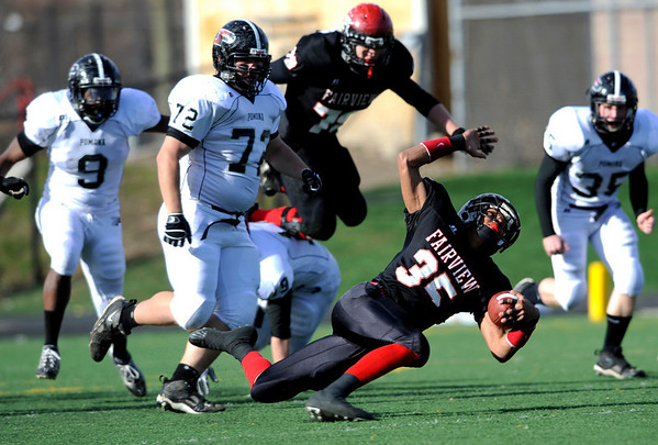 Fairview High School's Kenny Bell (35) ends the play as Pomona High School's Coy Mager (72) defends during the class 5A State Semifinals at Recht Field in Boulder, Saturday, Nov. 28, 2009. <br /> <br /> KASIA BROUSSALIAN /THE CAMERA