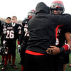 Fairview High School's Kenny Bell (35) hugs his coach after losing to Pomona High School, 42-26, during the class 5A State Semifinals at Recht Field in Boulder, Saturday, Nov. 28, 2009. <br /> <br /> KASIA BROUSSALIAN /THE CAMERA