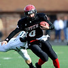 Fairview High School's Ben Schumacher (10) runs the ball while Pomona High School's Tanner Ryan (35) goes for a tackle during the class 5A State Semifinals at Recht Field in Boulder, Saturday, Nov. 28, 2009. <br /> <br /> KASIA BROUSSALIAN /THE CAMERA