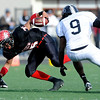 Fairview High School's Kenny Bell (35) ends a play after a carry while Pomona High School's Dustin Conley (34) and Daijon Tyler (9) defend during the class 5A State Semifinals at Recht Field in Boulder, Saturday, Nov. 28, 2009. <br /> <br /> KASIA BROUSSALIAN /THE CAMERA
